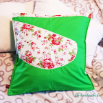 grüner Kissenbezug mit Rosenmuster